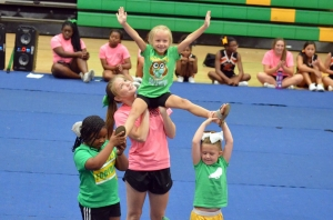 Campers during RSHS' cheer camp perform skills learned during last month's camp.