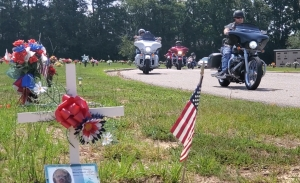 Motorcycles from several clubs roll into Richmond County Memorial Park to view the headstones of five Richmond County veterans that were paid for by the Operation Tombstone ride.