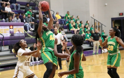 Junior Davionna Campbell (44) pulls in a rebound during Richmond's 24-point loss to Jack Britt on Friday.