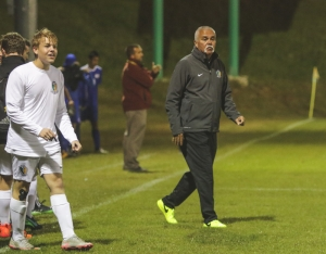 Head coach Bennie Howard (right) coached his final game as the Richmond boys head soccer coach after 30 seasons.