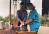 Associate Pastor Joe Polson, Cheraw First Baptist Church, blesses the hands of nurses in the courtyard at McLeod Health Cheraw on May 8, during a special Nurses Week Blessing of the Hands ceremony.
