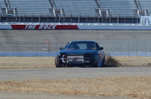 A driver in MB Drift's season opening Ice Breaker Challenge at Rockingham Speedway kicks up dirt after sliding into a curve on the road course. See more photos on the RO's Facebook page.