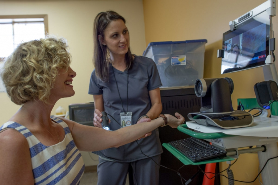 Dr. Carrie Castille is examined by a new telemedicine device used to examine patients while instantly transmitting the physical assessment back to an off-site nurse practitioner.