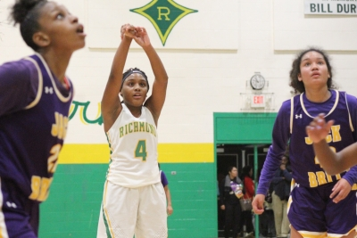 Senior Taliah Wall (4) hits the go-ahead free throw in the fourth quarter of Richmond's win over Jack Britt Friday.