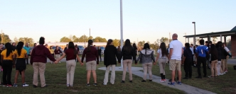 "Students and staff meet at Ellerbe Middle School for the annual ""Prayer at the Pole"" event."