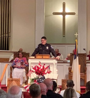 Hamlet Detective Corey Wilson tells the congregation of First Baptist Church that his career in law enforcement was a calling from God.