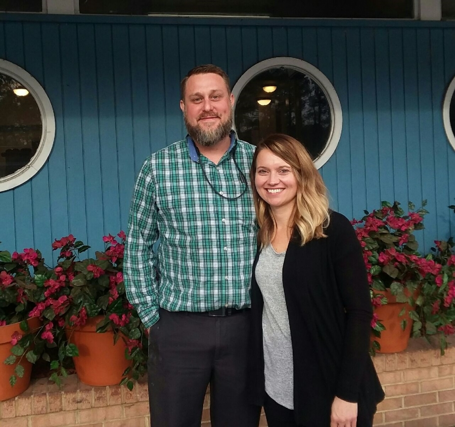 New owners Jeremy and Lindsay Gibson stand outside the Holiday Restaurant on its first day of being open after changing hands.