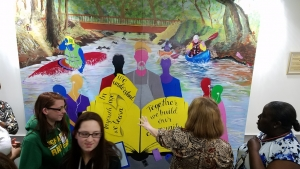 A new mural, created by youth and seniors working together, was unveiled Tuesday at the Richmond County Department of Social Services.