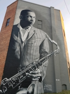 A mural of jazz legend John Coltrane on the back of the old Hamlet Theatre was recently completed by artist Scott Nurkin.