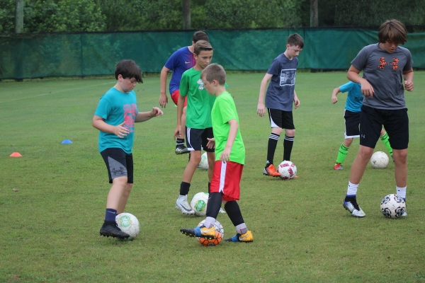 Campers work on dribbling drills during RSHS' soccer development camp last summer.