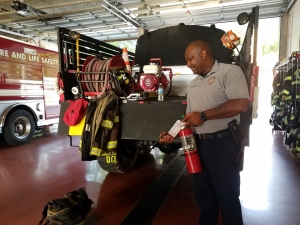 Rockingham Fire Chief Harold Isler Demonstrates Proper Use of Extinguisher
