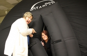 Debbie Knight and Shannon Hearne test out the StarLab portable planetarium at Leath Memorial Library on Friday.