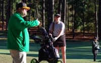 Senior Hailey Miller gets a tip from head coach Keith Parsons during Monday's NCHSAA 4A central regionals tournament.