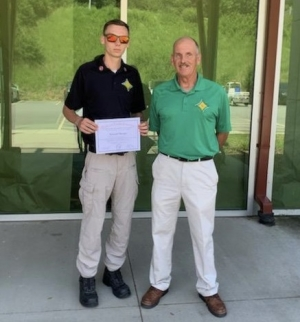 Rising senior Zac Sharpe completed the Office of State Fire Marshall High School Firefighter challenge at the Buncombe County Training Center in Asheville in June. Fire and Emergency Medical Technician Teacher Chief Victor McCaskill, as well as his parents, attended the graduation ceremony.