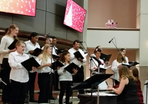 Members of the Richmond Community College choir sing during a Christmas concert Tuesday at Cole Auditorium.