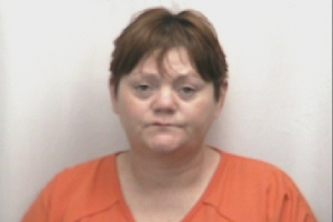 Jacqueline Lynch is accused of hitting a man in the back of the head with her fists and twice with a vehicle, assaulting another woman and threatening to kill her, and trying to burn her neighbors' home while three people were inside.