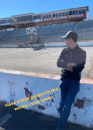 "NASCAR driver Joey Logano stands at the legendary North Wilkesboro Speedway, teasing a ""little project."""