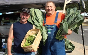 "Greg Shelley, better known as ""Collard Man"" (right) poses with his legendary collards."