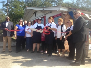 Members of Mamie's cut the ribbon to join Scotland County's Chamber of Commerce.
