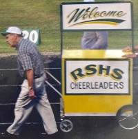 "Dr. Bill Haltiwanger pulls his ""Welcome Wagon,"" a staple at Richmond football games."