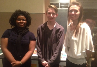 Art students Alexandria Baker (left) and Caleb Dickens (center) join instructor Andrea McIver at the Art Show.