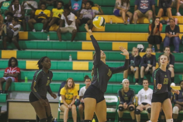 Senior middle hitter Brianna Baysek led a late third-game charge to lift Richmond past Lee County Wednesday night.
