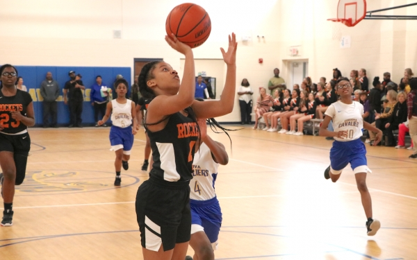 Rockingham's Keyoni Nichols drives to the basket during the second half, scoring two of her 18 points in Thursday's win.