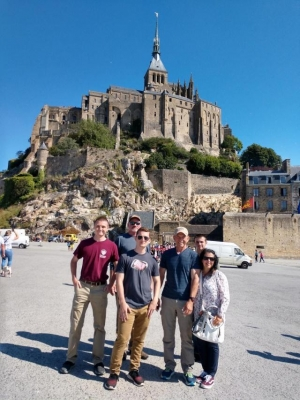 Richmond Raider Battalion cadets, instructor, and chaperones take a moment to pose for a photo before beginning the trek up Mont-Saint-Michel.