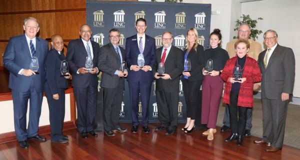 UNC Pembroke Chancellor Robin Gary Cummings (far right) with recipients of the 2019 Business Visions Awards. Left to Right: George Breece, Vanessa Abernathy, Ricky Harris, Ron Roach, Kyle Chavis, Walter White, Mary Elizabeth Williford, Cameron Cruse, Darwin Leggette, Milla Leggette, and Chancellor Cummings.