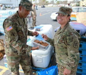 Soldiers enjoy baked goods sent by three local teens during Hurrican Irma disaster relief efforts.