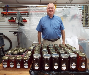Richmond County beekeeper David Snead stands behind jars of honey.