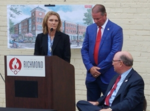 Richmond Community College President Dr. Dale McInnis, right, looks back at Kenneth and Claudia Robinette during the dedication ceremony for the college's upcoming downtown campus. The building, named for the Robinettes, will house the Leon Levine School of Business and Information Technology.