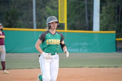 Freshman Payton Chappell smiles as she rounds the bases during her home run Wednesday.