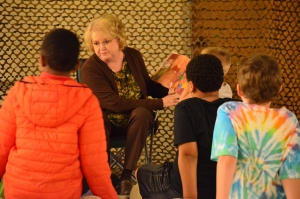 Peggy Wilkes reads a story about a scared mouse to children during the Family Literacy Night Camp-In at Leath Memorial Library on Wednesday. See more photos on the Richmond Observer's Facebook page.