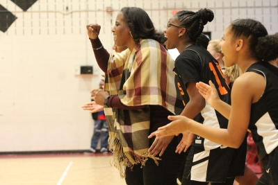 The Lady Rocket bench cheers as the final buzzer sounded in Tuesday's win over rival Hamlet.