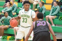 CJ Tillman scored 18 points and grabbed 12 rebounds in the JV Raiders' win over Jack Britt.