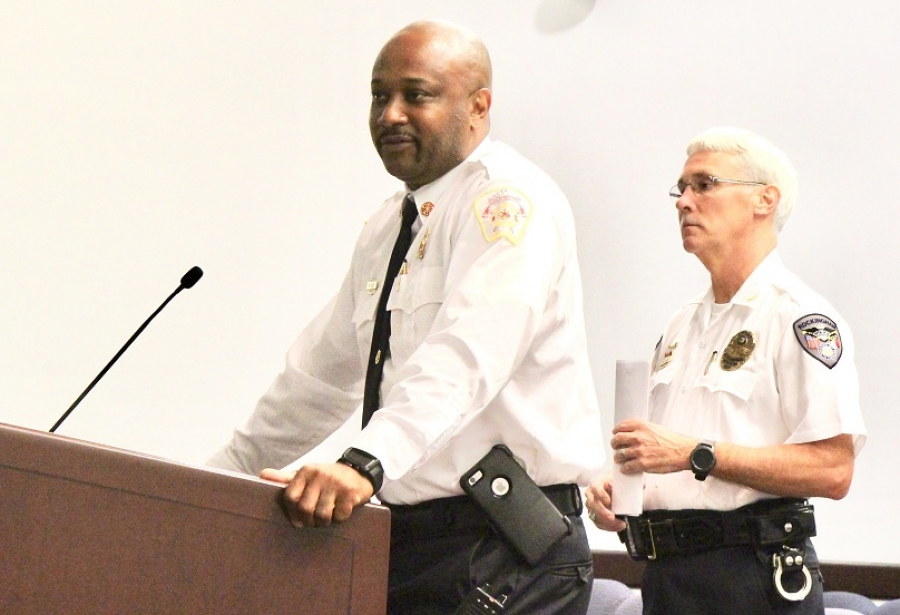 Rockingham Fire Chief Harold Isler, left, and Police Chief Billy Kelly describe the activities from last month's Junior Police and Fire Academy at Tuesday's City Council meeting.