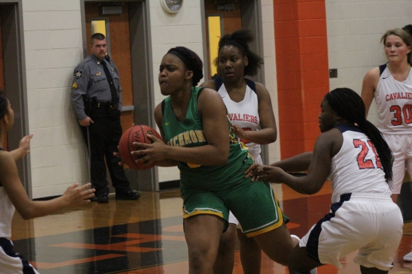 Junior center Jardai Tillman (green) scored eight points in Richmond's win over Southern Lee.