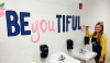 "Rockingham Middle School's visual arts teacher Ashley Lupfer reminds students they are ""be-you-tiful"" by painting a mural in a student bathroom."