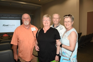Marlene Thomas (second from left) and her twin sister Darlene Reeves (far right) are pictured here with their husbands at FirstHealth's annual Cancer Survivors Day celebration.