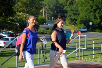 Two students head to class on the first day of fall semester at Richmond Community College.