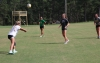 Seniors Shelly Hoffman (left), Georgia Grace Anderson (center) and Taylor Chappell (right) work on passing drills Tuesday while coach Ashleigh Larsen watches.