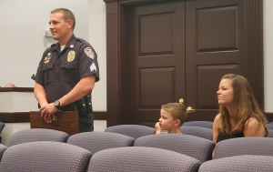 Sgt. Marcus Ricks of the Rockingham Police Department, joined by his son, Jackson, and wife, Christina, was recognized Tuesday for completing the Tactical Training Certificate Program.