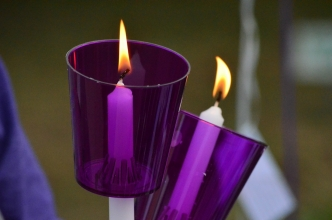 Everyone who attended a candlelight vigil for domestic violence victims Tuesday was given a candle with a purple cover.