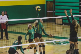 Senior middle hitter Brianna Baysek slams one of her five kills during Tuesday's match against Pinecrest.