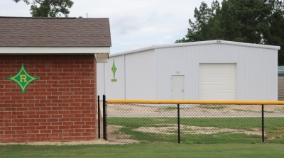 The new Lady Raider softball locker room (left) and indoor hitting facility (back) are near completion.