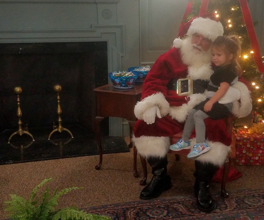 Santa meets with one of his 200 guests during Monday's visit to Leath Memorial Library in Rockingham.