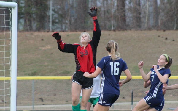 Richmond sophomore keeper Kelly Hoffman (33) leaps to tip away a corner kick in the first half.