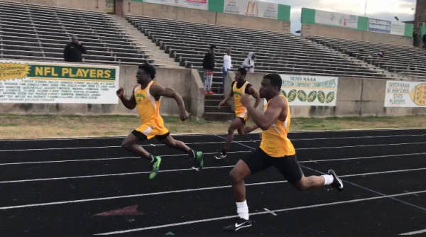 Richmond's Dante Miller (left) runs to a 10.60 second finish in the 100-meter dash while two of his teammates finish right behind him.