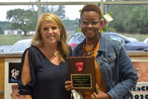 Vanecia Johnson, a math teacher at Richmond Early College High School, poses with principal Joy Smart after being named Teacher of the Year.